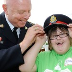 Here, special friends participant Jessica Knapman ,16, gets a thrill as she tries on Halton police chief Stephen Tanner's  hat for size.